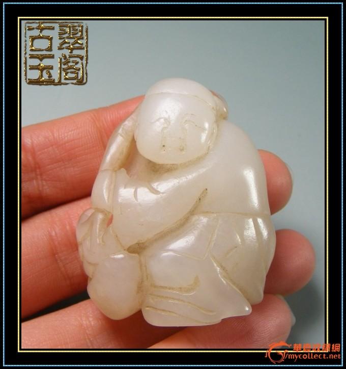 清代-和田白玉玉质表面带沁圆雕执灵芝童子把件
