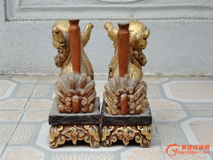 潮州木刻:樟木雕祥云长莲底座含珠踏球带烛台狮一对